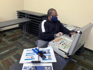 man working on copper program